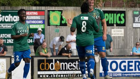 Sam Corcoran is congratulated by his colleagues after scoring for Hendon (Pic: DBeech Photography)