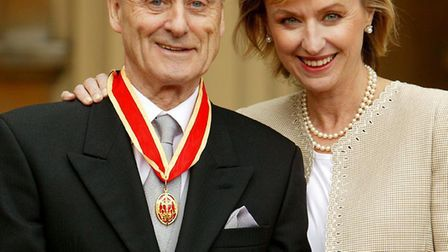 Sir Harold Evans receives his knighthood with wife Tina Brown in 2004. Picture: PA