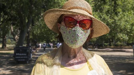 A Hackney resident wears a mask in the summer of 2020. Picture: Alex Amoros