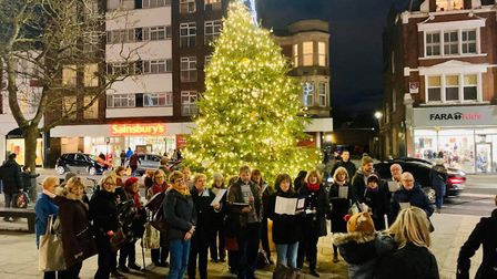 Choir singers outside Muswell Hill's Christmas tree in 2019. Picture: Deanna Bogdanovic