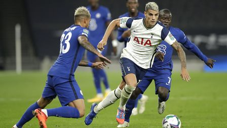 Tottenham Hotspur's Erik Lamela (centre) battles for the ball with Chelsea's Emerson Palmieri (left)