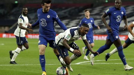 Chelsea's Ben Chilwell (left) and and Tottenham Hotspur's Steven Bergwijn battle for the ball during