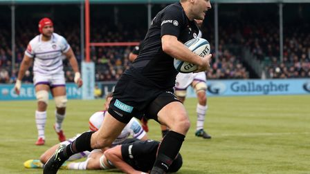 Saracens' Richard Wigglesworth breaks through the Leicester defence to score the first try during th