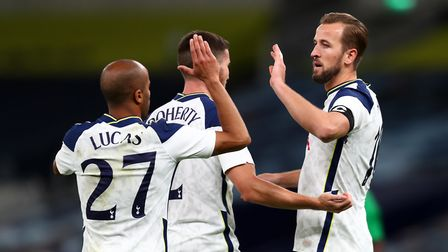 Tottenham Hotspur's Harry Kane (right) celebrates scoring his side's fifth goal of the game during t