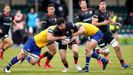 Saracens' Dom Morris (centre) is tackled by Bath's Rhys Priestland (right) and Sam Underhill during