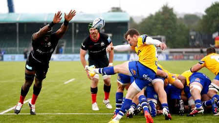Bath's Ben Spencer kicks the ball under pressure from Saracens' Maro Itoje (left) during the Gallagh
