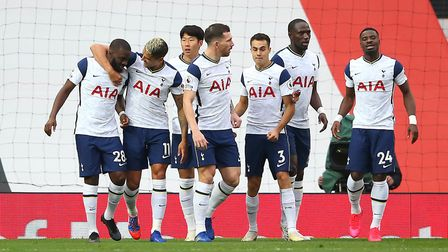 Tottenham Hotspur's Tanguy Ndombele (left) celebrates with team-mates after scoring his side's first