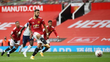 Manchester United's Bruno Fernandes scores from the penalty spot