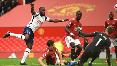 Tottenham Hotspur's Tanguy Ndombele (left) scores his side's first goal of the game