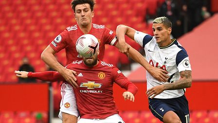 Tottenham Hotspur's Erik Lamela (right) battles for the ball with Manchester United's Harry Maguire