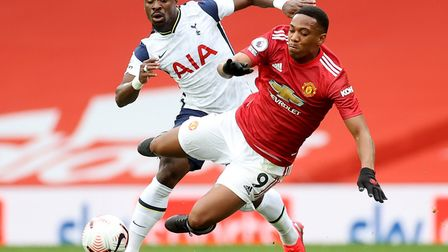 Manchester United's Anthony Martial (right) challenges Tottenham Hotspur's Serge Aurier