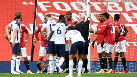 Referee Anthony Taylor shows a red card to Manchester United's Anthony Martial