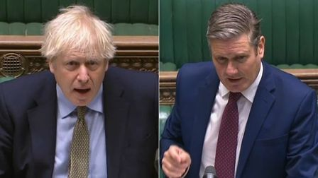 Boris Johnson (L) and opposition leader Sir Keir Starmer in the House of Commons