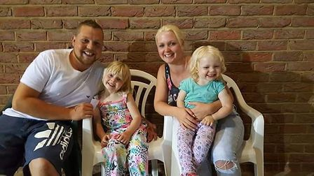 Louis Burns with his fiancee Clare, and two children Lily and Rosie. Picture: Louis Burns