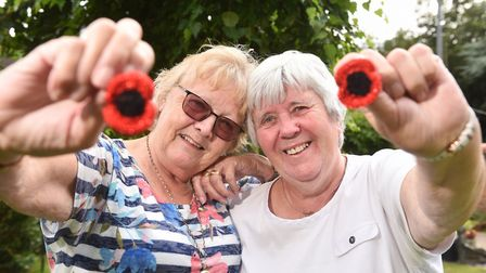 Fundraisers Zoiyar Cole and Janet Ellis with the crocheted poppies. Picture : ANTONY KELLY