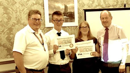 Pictured are Aidan Watling and Jade Snowden completing their talk and being presented with their cer