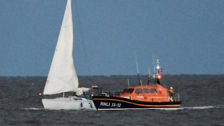 The stricken yacht is helped by the Lowestoft lifeboat crewPicture: RNLI/Mick Howes