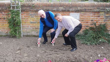 Pictured are Rev Michael Asquith and Rev Geoff Wilson placing the first two crosses with poppies on
