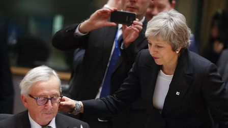 British Prime Minister Theresa May, right, greets European Commission President Jean-Claude Juncker
