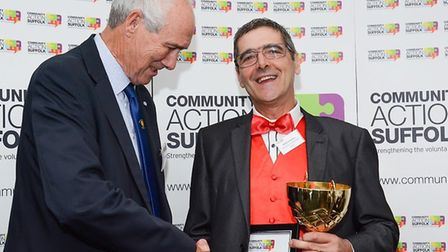 Pictured left Ian Campbell MBE and on the right is Mark Knowles( in red bower) - the winner of the I