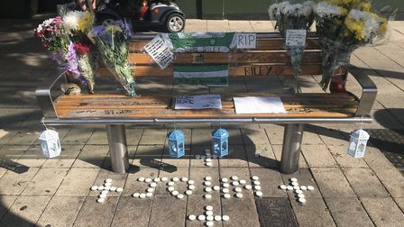 Police have launched an investigation after a man was filmed spitting on John Rileys shrine outside