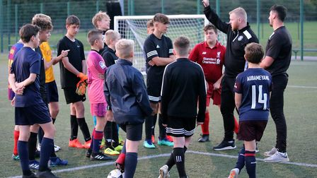 Lowestoft Town FC coaches Travis Cole and Bob Charlton training youngsters at Barnards soccer centre