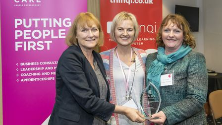 Author and coaching expert Julie Starr (centre) presents the Best Coaching and Mentoring Initiative