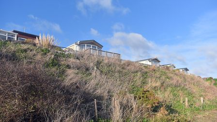 The cliffs at Pakefield beach have been badly eroded. Holiday homes at Pakefield Caravan Park have b