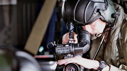 Mr Dua during a video shoot aboard one of HMS Ark Royals' Seaking Helicopters during Operation Telic
