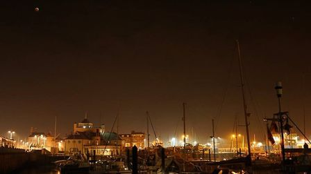 The 'super blood wolf moon' gives Lowestoft Harbour a reddish glow this morning. Picture: Nigel Bain