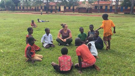 Former Pakefield High School student Jess Green, pictured with Ugandan children, spoke to current st