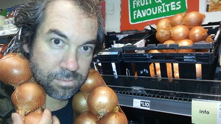 David West with onion multipacks at Sainsbury's in Stroud Green Road. Picture: Penelope Diaz