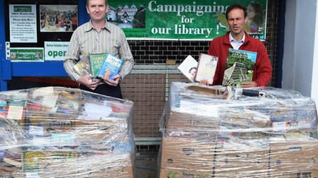 Francis Henry of Daniels Estate Agents. left, and Cllr Paul Lorber outside the volunteer Library