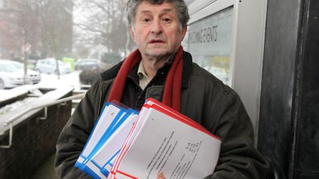 Martin Redston hands in documents at Brent Town Hall