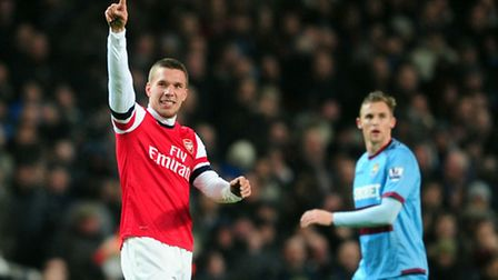 Arsenal's Lukas Podolski celebrates his brilliant equaliser against West Ham, and the German went on