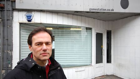 Liberal Democrat group leader Cllr Paul Lorber outside the shop