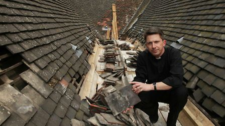 Revd. David Clues on the roof of St. Mary's Church in Neasden