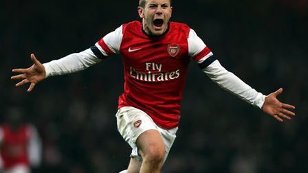Arsenal's Jack Wilshere celebrates scoring the 86th-minute winner during the FA Cup Third Round Repl