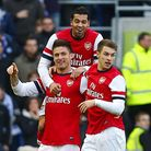 Arsenal players celebrate at Brighton on Saturday after earning a fifth round FA Cup tie with Blackb
