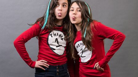 Left to right: Greta Nuzi,12 and Aliyah Yousaf, 11 get into the spirit for Reading for Enjoyment Day
