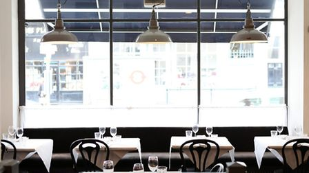 The upstairs dining room is filled with natural light