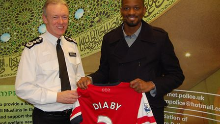 Arsenal footballer Abou Diaby (right) and Commissioner Sir Bernard Hogan-Howe