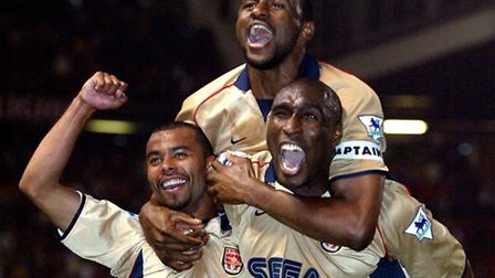 Arsenal's Ashley Cole, Patrick Vieira and Sol Campbell celebrate completing the double in 2002 after