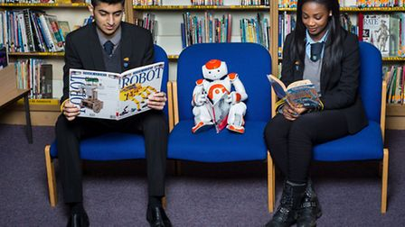 Rishi Bhudia, Head Boy, aged 17and Vanessa Magnusen, Head Girl, aged 17 with robot NAO. (Pic credit: