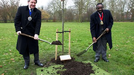 Cllr Michael Adeyeye, Mayor of Brent and Roger Gifford, the Lord Mayor of the City of London, plant