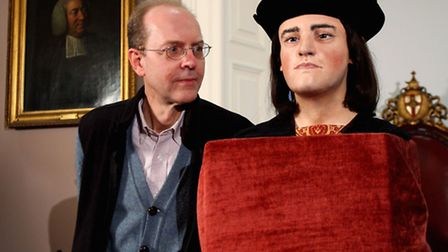 Michael Ibsen, a descendant of of King Richard III, poses for photographers as the face ofthe king
