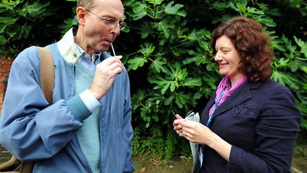 Dr Turi King from Leicester University gives Michael Ibsen a DNA swab during an archaeological searc