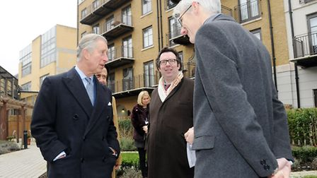 The Prince of Wales in the courtyard of Highbury Gardens with London's Deputy Mayor for Housing Rich