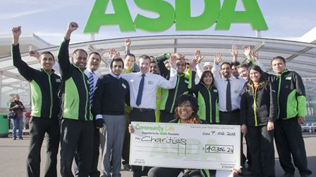 Staff at ASDA in Park Royal are celebrating after raising thousands of pounds for charity