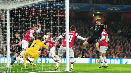 Bayern Munich's Thomas Muller (right) scores their second goal of the game against Arsenal